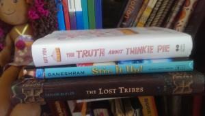 MG books on a shelf