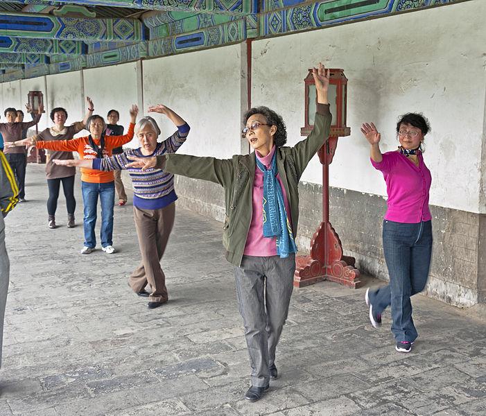 Older_women_practicing_dance_at_Temple_of_Heaven_Park,_Beijing